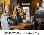happy female friends conversing ... | Shutterstock . vector #146623217