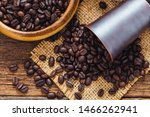 Coffee Beans On Wooden Table...