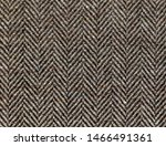 Stock photo brown woolen fabric striped zigzag herringbone tweed wool background texture coat close up 1466491361