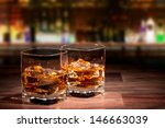 Small photo of Whiskey drinks on wood