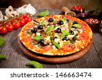 italian pizza served on wood | Shutterstock . vector #146663474