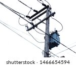 Small photo of Transformer on the pole in the side view: convert the high voltage energy into low voltage and supply electricity through the power cable to the receiver. On a white sky background.