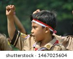Small photo of Bogor west java / Indonesia August 14, 2014 ; Indonesian scout dance with dancers carrying semaphore flags, dance, karate, egrang, hoola hoop.