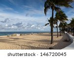 Beach Chairs on Empty Beach in Ft. Lauderdale, Florida - stock photo