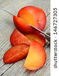 red plums cut into slices on a... | Shutterstock . vector #146727305