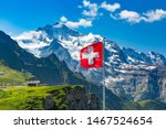 Swiss flag waving and tourists...