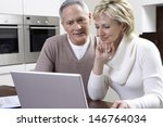 happy middle aged couple using... | Shutterstock . vector #146764034