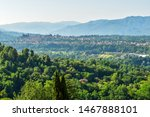 Stunning view of Tuscan hills. The village of Lucca seen in the distance. Beautiful summer day. Barga, Italy -Image