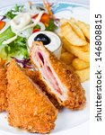 Small photo of Cordon bleu and french fries served on white plate