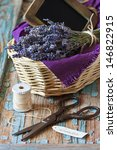 Provence lavender and scissors on an old wooden board. - stock photo