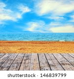 Sandy beach and seascape with wooden floor - stock photo