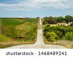Hilly Rural Road Between Green...