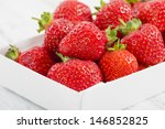Strawberries - Box of hand picked strawberries. Delicious summer treat! - stock photo