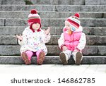 Two Funny Girls Sitting On The...