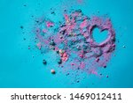 Heart drawn in fairy sparkle sand dust smashed crashed bath bomb or yet shadow on blue bright background