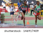 Small photo of DONETSK, UKRAINE - JULY 12: Op'T'Hoog, France, Jepkemei, Kenya, and Ansa, Ethiopia compete in 2000 m steeplechase during 8th IAAF World Youth Championships in Donetsk, Ukraine on July 12, 2013