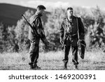 Small photo of Gamekeepers sunny fall day. Gamekeeper occupation concept. Hunting with partner provide greater safety fun and rewarding. Gamekeeper rifles nature environment. Gamekeepers walk mountains background.