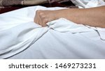 Small photo of Terminally-ill woman clenching bedsheets feeling terrible pain, death convulsion