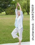 Small photo of best ager women practicing yoga and tai chi outdoors