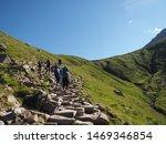 Mountain Walkers Climbing Stee...