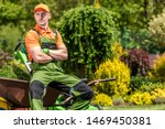 Professional Gardener Job. Satisfied Caucasian Garden Worker in His 30s Relaxing During Mid Day Work Break. Landscaping Industry. - stock photo