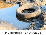 A Discarded Old Tyre In A...