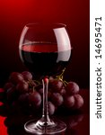 a glass of red wine grape - stock photo