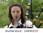 Young Girl Playing The Bagpipes