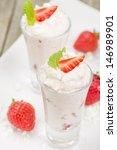 Eton Mess - Strawberries with whipped cream and meringue in shot glasses. Classic British summer dessert. - stock photo
