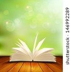 open book on a wooden floor in... | Shutterstock .eps vector #146992289
