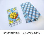 Small photo of Odessa/Ukraine-July 25,2019:Tarot Rider Waite esoteric deck with major arcane Wheel of Fortune on white background