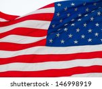 american flag flying in a light ... | Shutterstock . vector #146998919