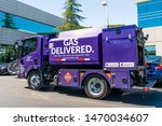 Small photo of August 1, 2019 Redwood City / CA / USA - Booster Fuels Inc mini tank making deliveries in Silicon Valley; Booster is an on demand app-based service that delivers and pumps gas in office parking lots