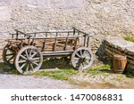 An Old Cart With Wood And A...