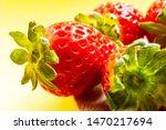 strawberries in a wooden spoon... | Shutterstock . vector #1470217694