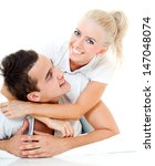 young happy couple. isolated. | Shutterstock . vector #147048074