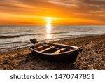 Fishing Boat On The Lake At...