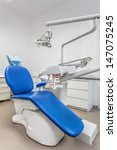 Vertical view of a dentist room with blue seat - stock photo