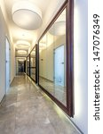 Long modern corridor with mirrors on the walls - stock photo