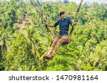 young man swinging in the... | Shutterstock . vector #1470981164