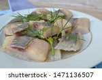 Stock photo delicious salted herring with dill salt and pepper on old white plate 1471136507
