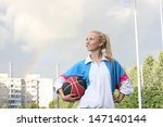 Young Sporty Girl Holding...