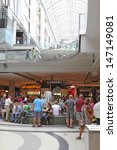 Small photo of TORONTO, ONTARIO - July 24: Shoppers in the Toronto Eaton Centre, July 24 2013. The Centre, Toronto's premiere shopping destination, announces a philanthropic partnership with The Remix Project.