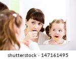 Mother Teaching Kid Teeth...