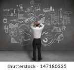 stressed businessman looking at ... | Shutterstock . vector #147180335