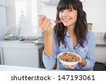 Attractive Brunette Eating Bowl ...