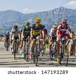 Small photo of LA ROCHETTE, FRANCE- JUL 16: The peloton pedaling on a plain road after the ascension to Col de Manse in The Alps during the stage 16 of 100 edition of Le Tour de France on July 16 2013 in La Rochette