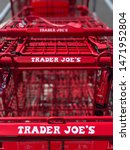 Small photo of Spokane, WA/USA - August 2019: Close up view of row of Trader Joe's red shopping baskets. Trader Joe's is an American chain of grocery stores specializing in gourmet, organic and vegetarian foods