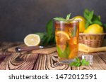 Glass Of Iced Tea With Mint An...