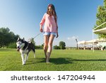 Stock photo girl and her faithful husky 147204944